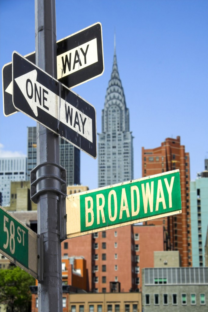 Broadway sign in front of New York City skyline
